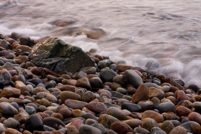 Waves And Smooth Stones