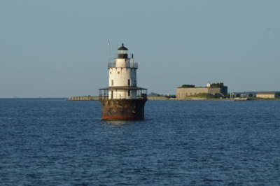 Lighthouse With Fort Taber In Background