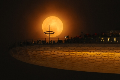 The Supermoon Rises Above The Marina Bay Sands Skypark.