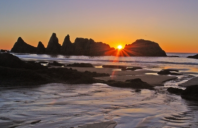 Setting Sun At Seal Rock During Low Tide