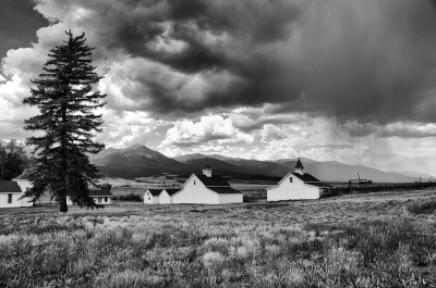 Ranch Buildings And Rain Clouds