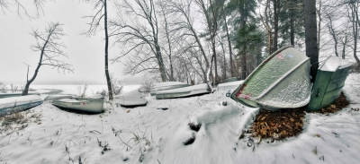 Mosaic Panorama During Winter Snowfall With Boats, Snow, And Trees