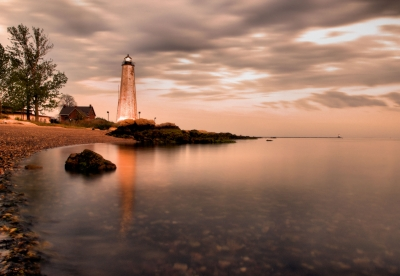 Amber Lighthouse Reflections