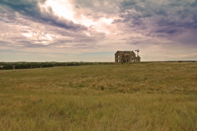 Abandoned Limestone Farmhouse On The Kansas Prairie