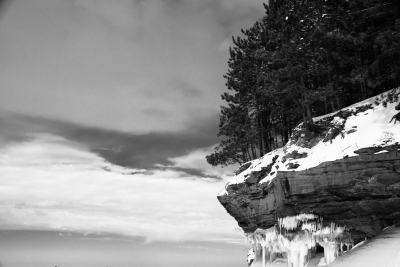 Trees And Cliff And Clouds