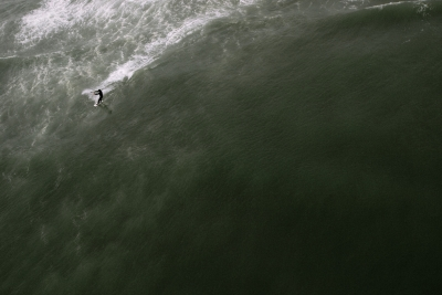 Kite Surfer Cuts Through The Waves In The North Sea Off Loekken Beach, Denmark