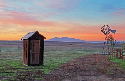 Sunrise Beyond The Outhouse