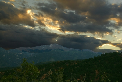 Evening Falls On A Snow Dusted Pikes Peak