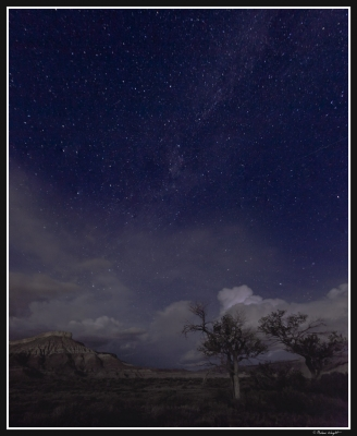 Clouds And Stars Over The Desert