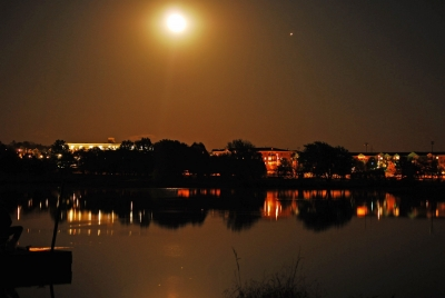 Lake Community Under Full Moon
