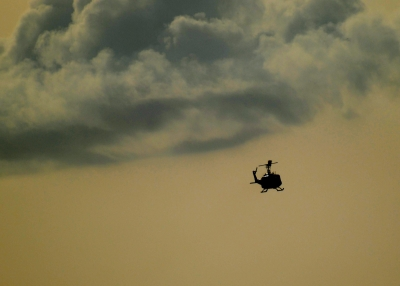 Chopper Under Pensicola Storm Clouds