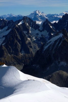 Hikers On Snowfields In The French Alps