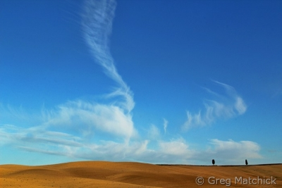 Clouds In Flight Over A Tuscan Ridge