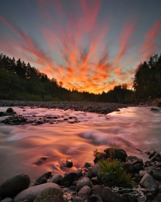 Sunset Clouds Over The Sandy River