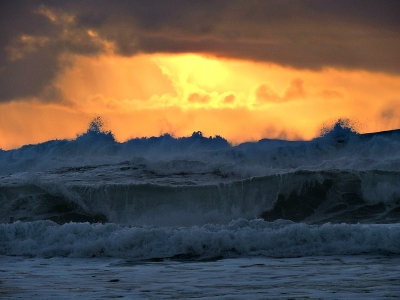 Angry Seas And Brillant Sunset