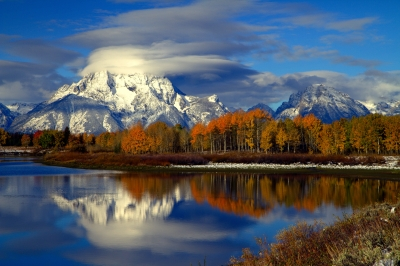 Mt. Moran Draped With The First Snow Of The Season, Reflects In The Still Morning Waters Of The Snake River