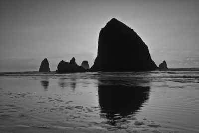 Haystack Rock At Sunset With High Tide