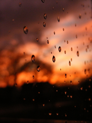 Raindrops On Window At Sunset