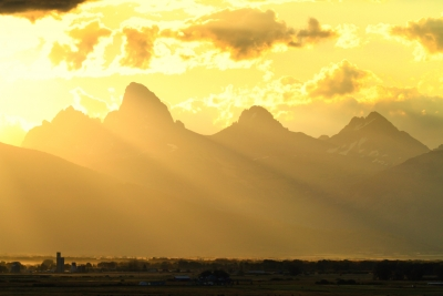 Tetonia, Idaho Grain Silos In The Valley, Give Depth To The Tetons Back Lit From The Sunrise Of A New Day