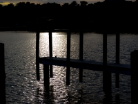 Silhouette Of Dock At Sunset