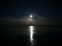 Moon On Frozen Little Bay De Noc