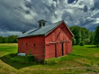 Stormy Skies Over Red Barn