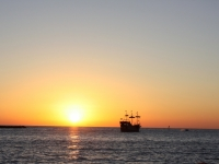 Pirates Sailing Off Int The Sunset
