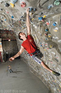 Ivan Greene on a climbing wall at New York''s Chelsea Piers Sports Center.