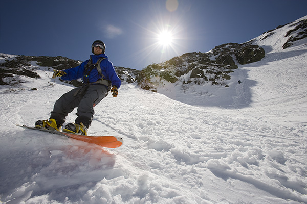 A snowboarder in Tuckerman Ravine in New Hampshire's White Mountains.