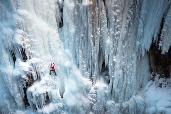 Climber Dawn Glanc ice climbing in Ouray Ice Park Colorado by Michael Clark