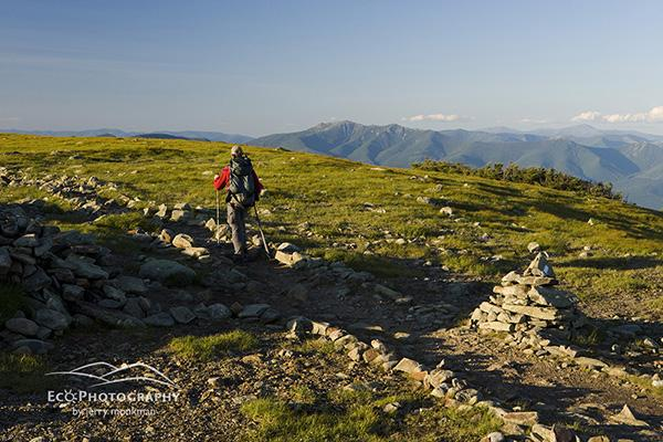 A hiker on the Appalachian Trail on the summit of Mount Moosilauke in New Hampshire's White Mountains.