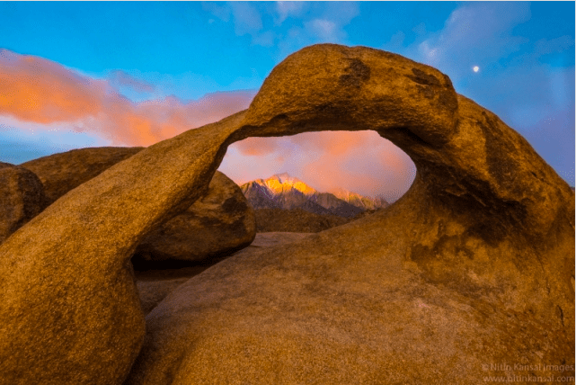 Through Arch - Mountain And Moon by Nitin Kansal
