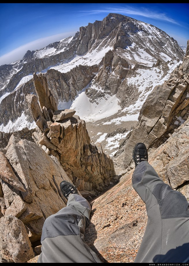Brandon Riza mountain climbing tour legs overhanging cliff