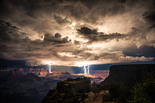 Long extended exposure of Moran Point overlooking the Grand Canyon in Arizona with multiple lightning strikes over the rim of the valleys in the distance