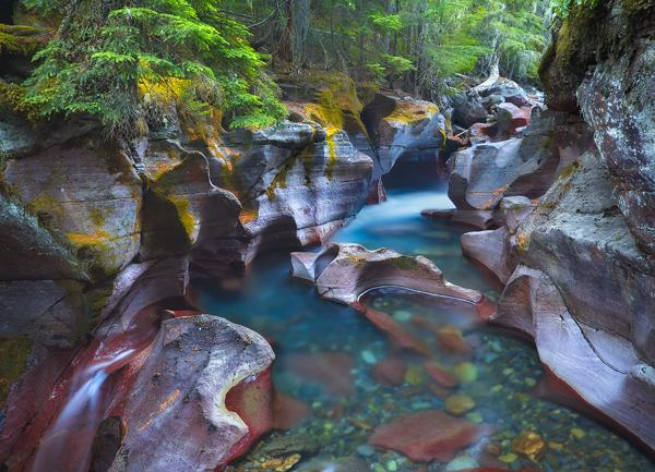 Composite of multiple exposures Avalanche Creek Glacier National Park Montana creek bed rocks polarizer