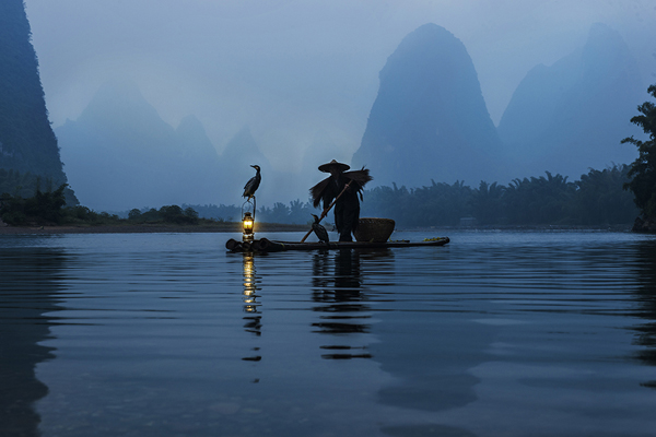 A fisherman on the Li River outside Xingping, Guilin Province, China