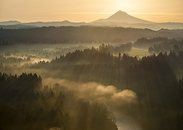 fog rolls in over Mount Hood and the forest in Sandy, Oregon
