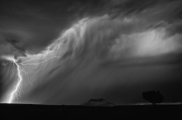 Long exposure of lightning captured at Cerro Cuate hill in San Ysidro New Mexico black and white image photography