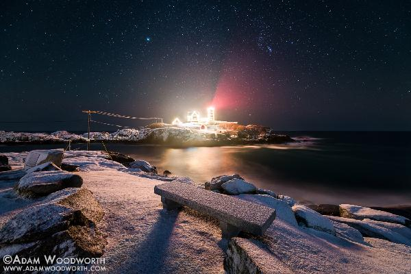 Composite photograph of several long nighttime exposures of Nubble Lighthouse against the Atlantic Coast in York, Maine