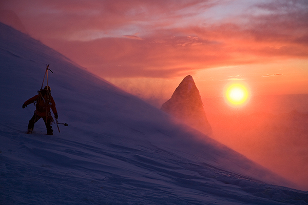 Yoshiko Mayazaki heading back up to the Aiguille du Midi as a winter storm clears for sunset