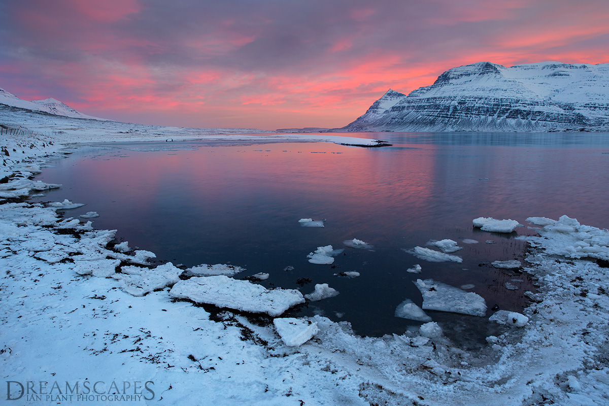 Sunset-over-fjord,-East-Fjords,-Iceland