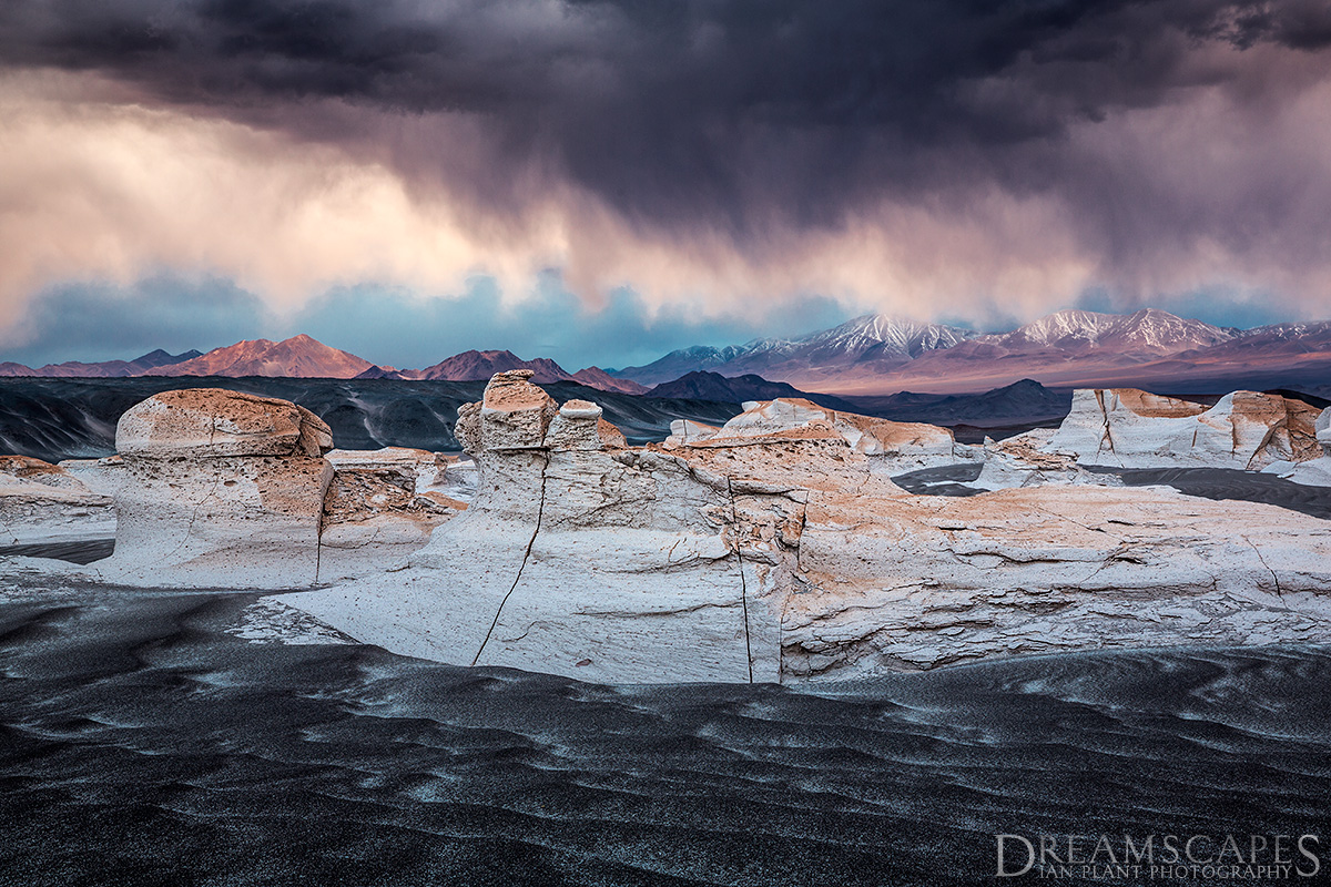 Sunset-storm-over-pumice-stone-field-and-mountains,-Argentina