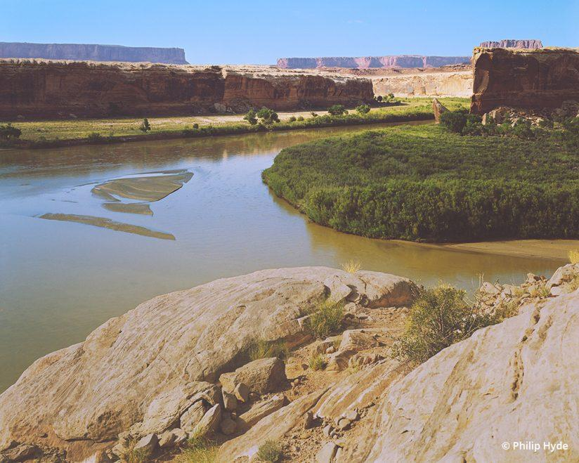 Green River at Anderson Bottom, Canyonlands National Park, Utah, 1971. From Slickrock: The Canyon Country of Southeast Utah by Edward Abbey (1973). Part of campaign to expand Canyonlands and eventually led to the establishment of Grand Staircase-Escalante National Monument. Photo by Philip Hyde.