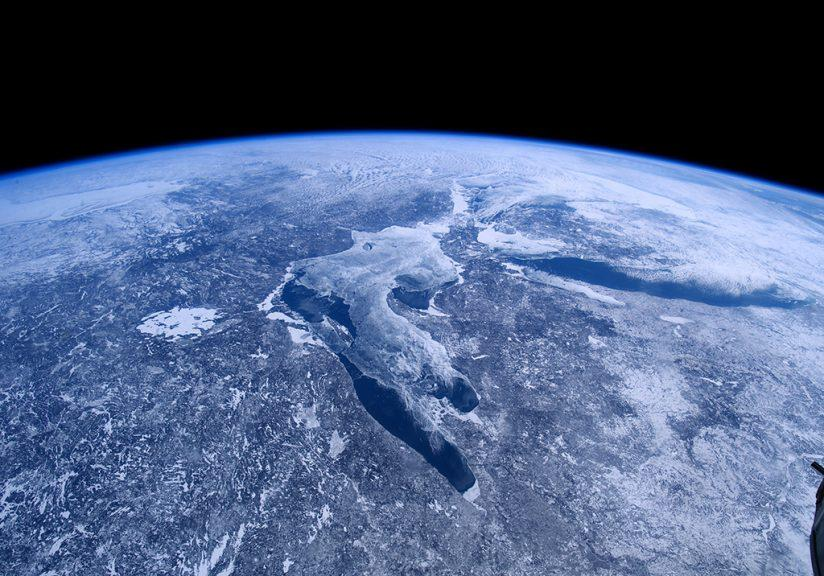 "A scene from the IMAX® film ""A Beautiful Planet"". Earth's climates can be seen from space. In this image, the great lakes of North America lie trapped in ice and snow. © 2016 IMAX Corporation. Photo courtesy of NASA."