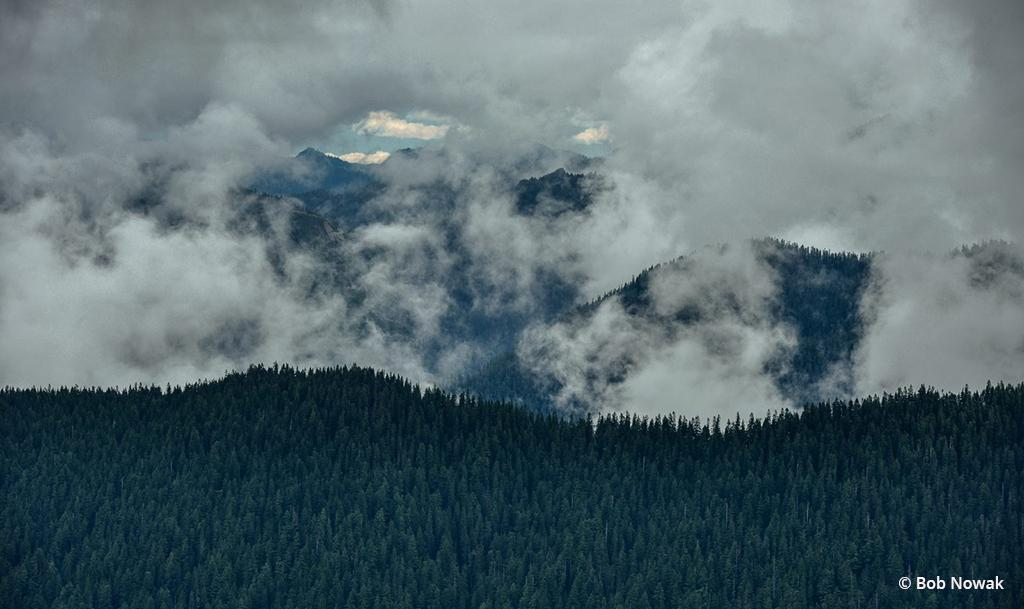 """Today's Photo Of The Day is """"Clouds over Tonga Ridge"""" by Bob Nowak. Location: Alpine Lakes Wilderness, Washington."""