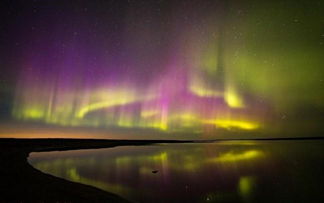 Beautiful aurora borealis reflects off a tundra lake in Nunavik - photo copyright Andrew Blomfield