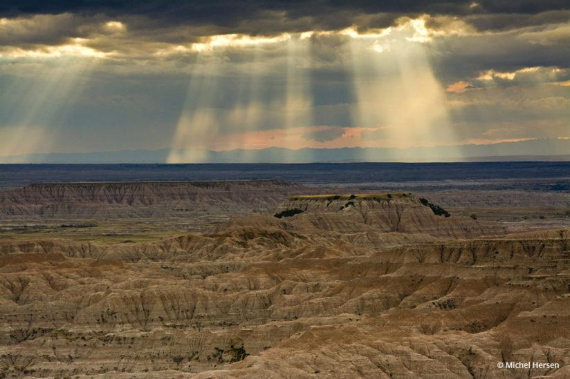 Today's Photo Of The Day is Crepuscular Rays over the Badlands by Michel Hersen. Location: Badlands National Park, South Dakota.