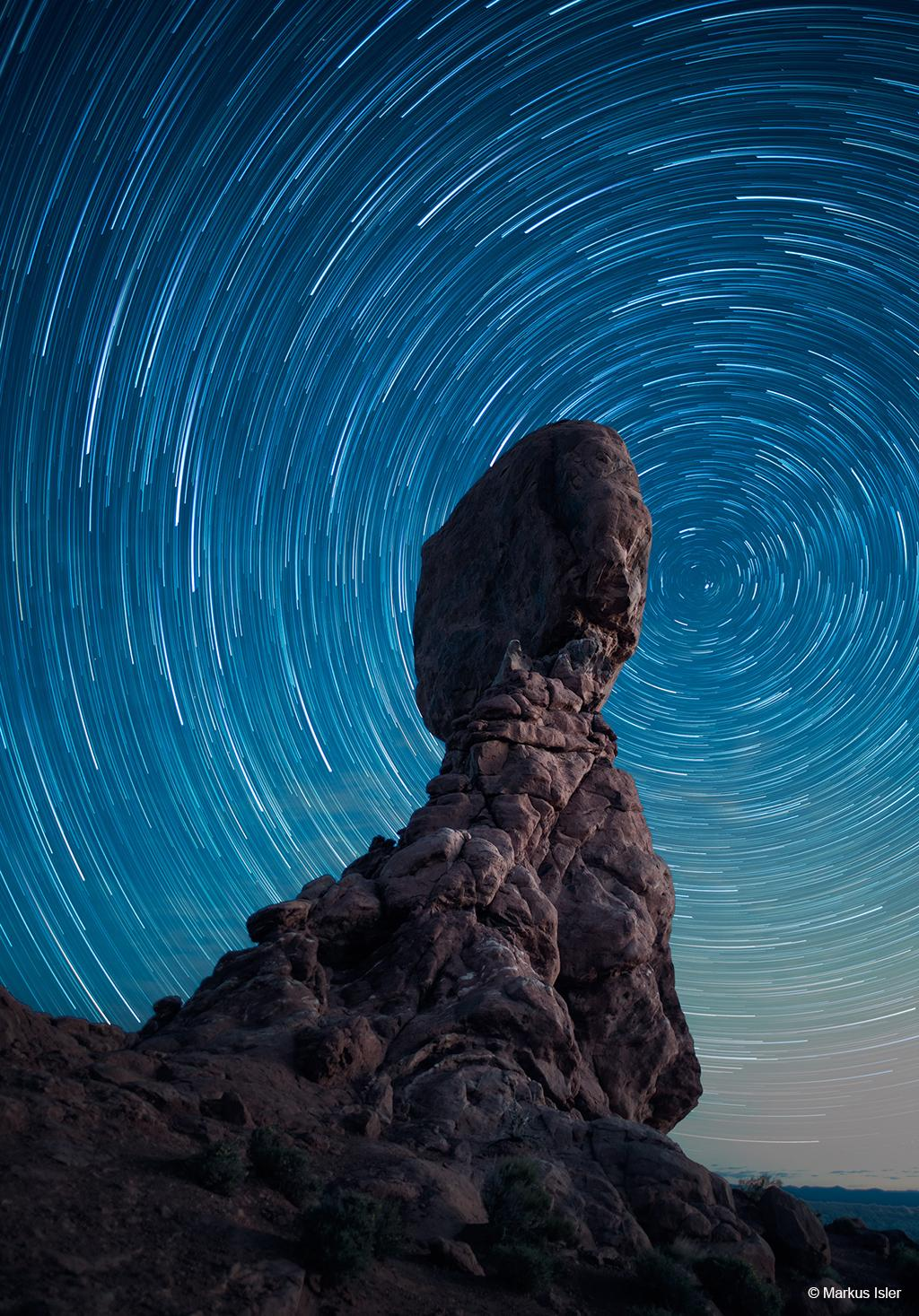 Today's Photo Of The Day is Revolving around the Balanced Rock by Markus Isler. Location: Arches National Park, Utah.