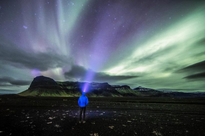 Standing under the Northern Lights in Iceland.