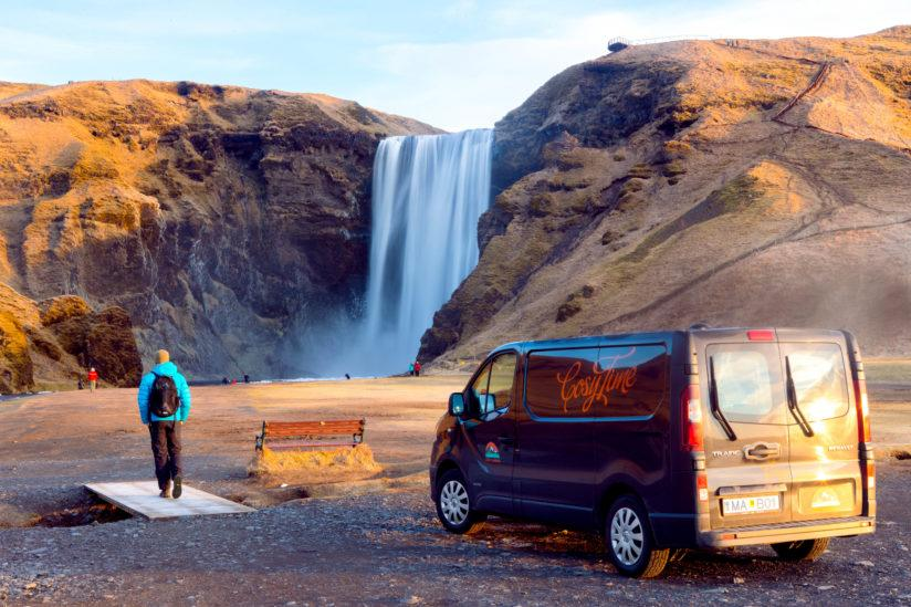 A campervan in front of Skogafoss